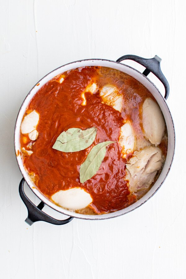 Chicken adobo stewing in a pot.