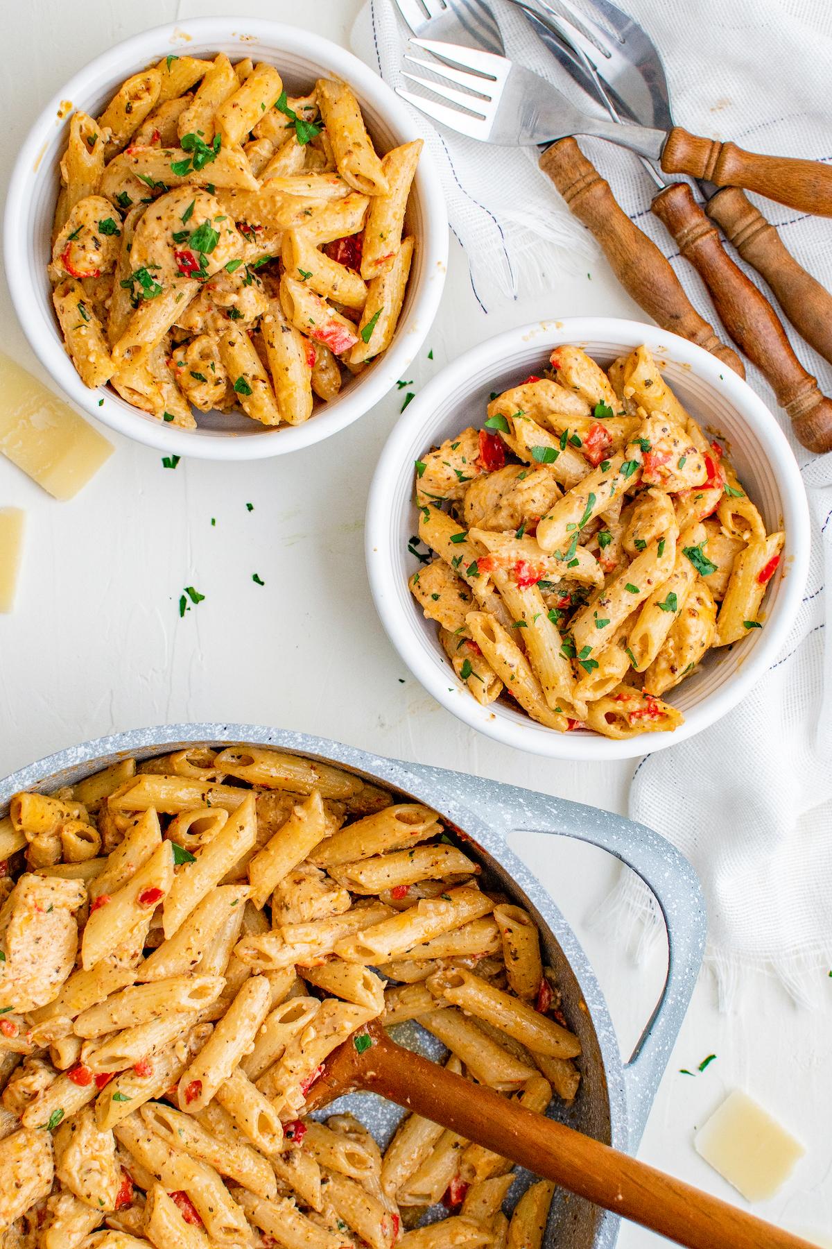 Two bowls of Cajun chicken pasta.