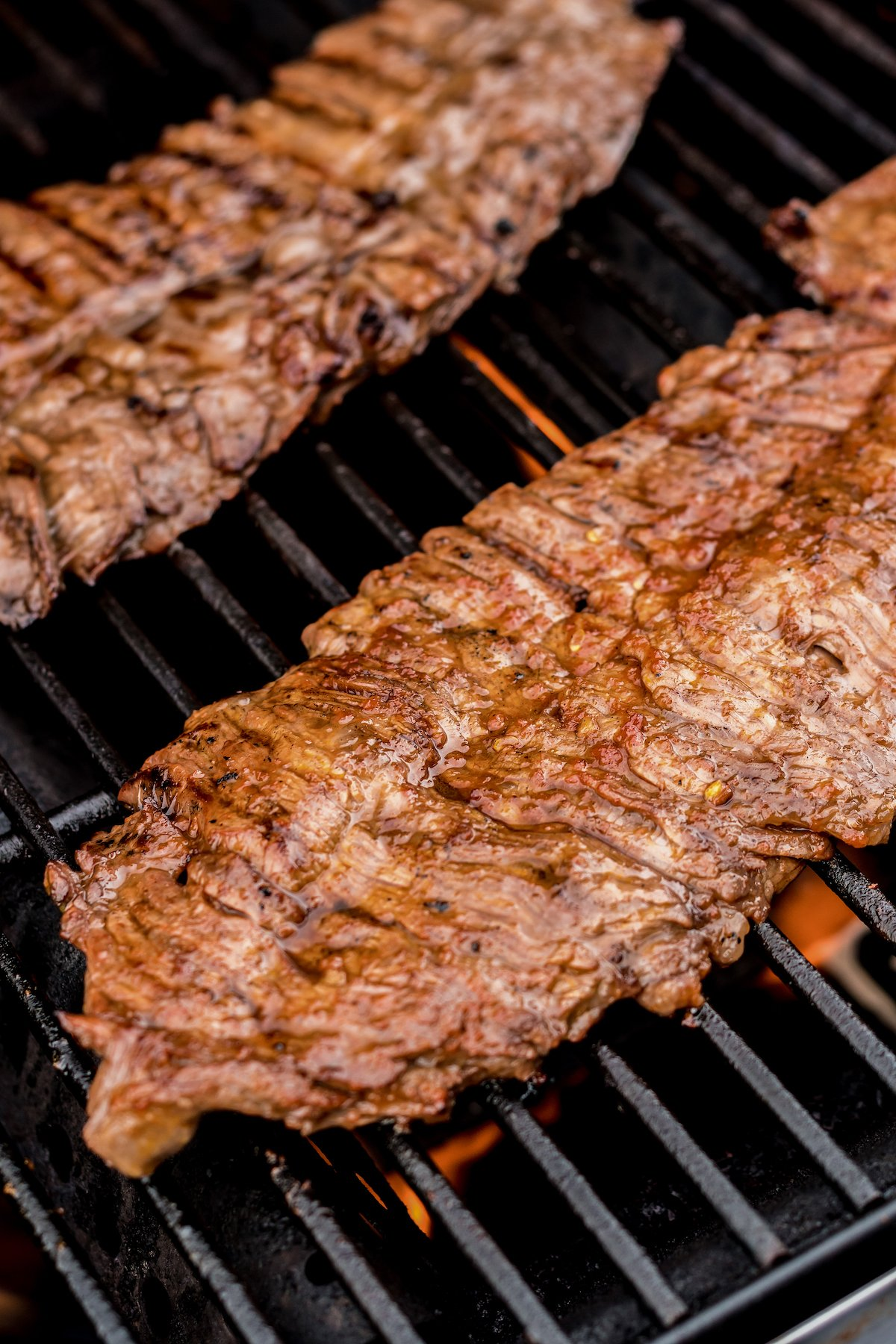 Flank steaks on the grill.
