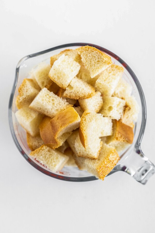 Bread cubes in a measuring cup.