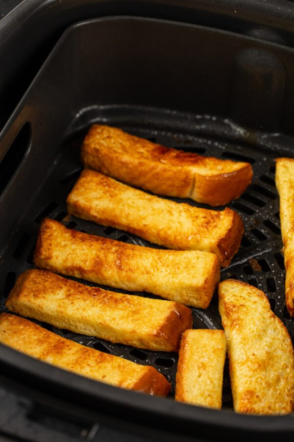 French toast sticks are browned and cooked in the air fryer.