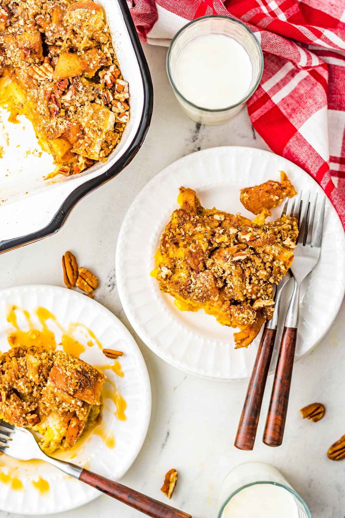 Two plates of apple pie french toast casserole.