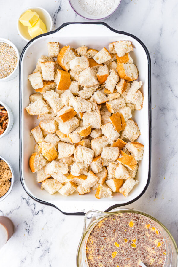 French bread cubes in a baking dish.