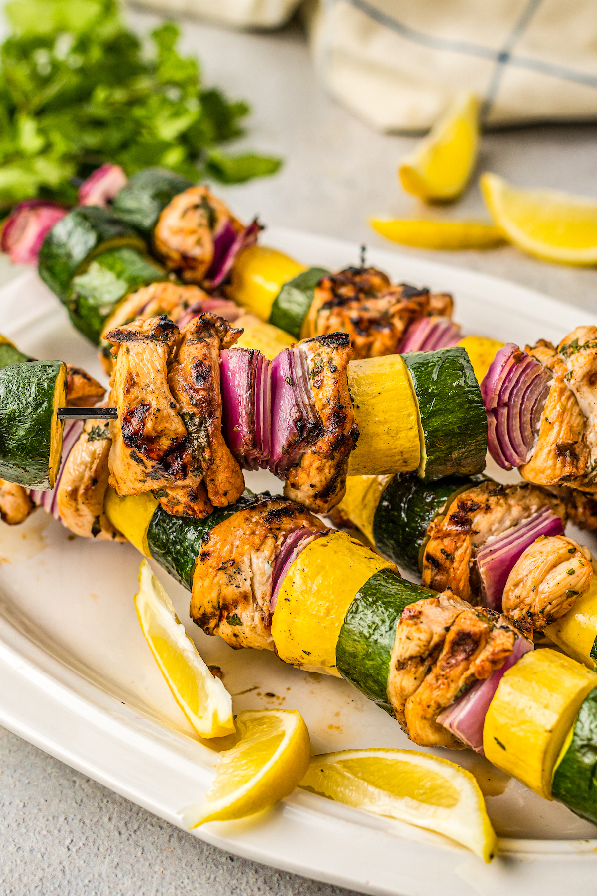 Plate of marinated chicken kabobs.