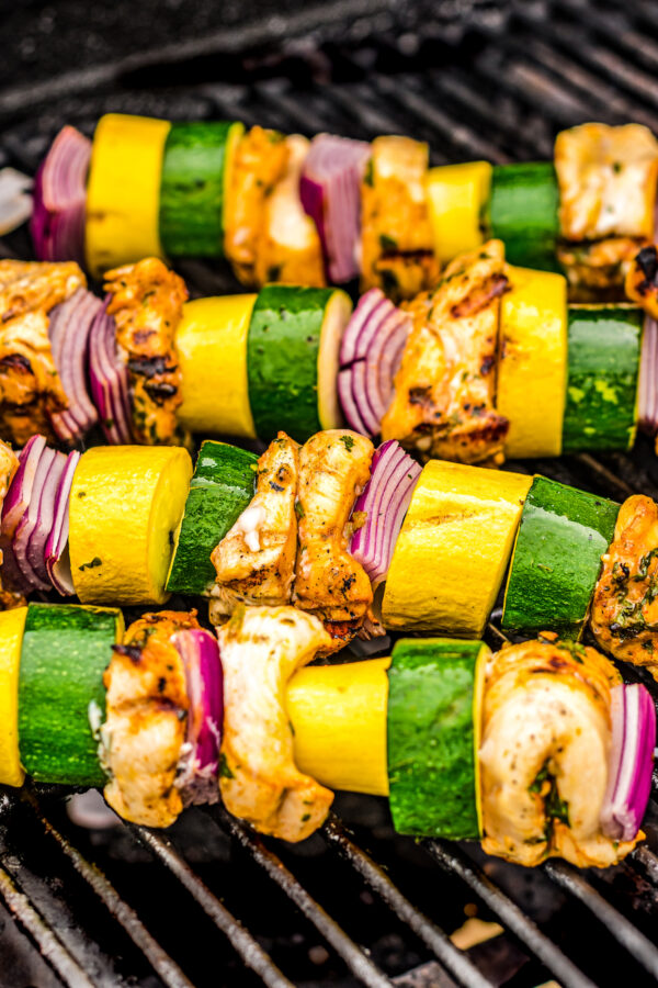 Chicken kabobs cooking on the grill.