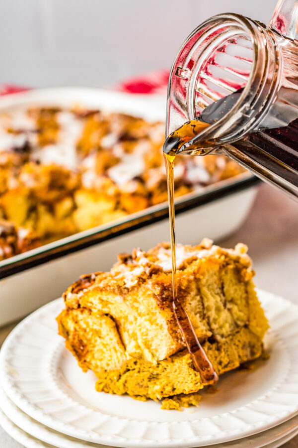 Maple syrup poured over a french toast bake.