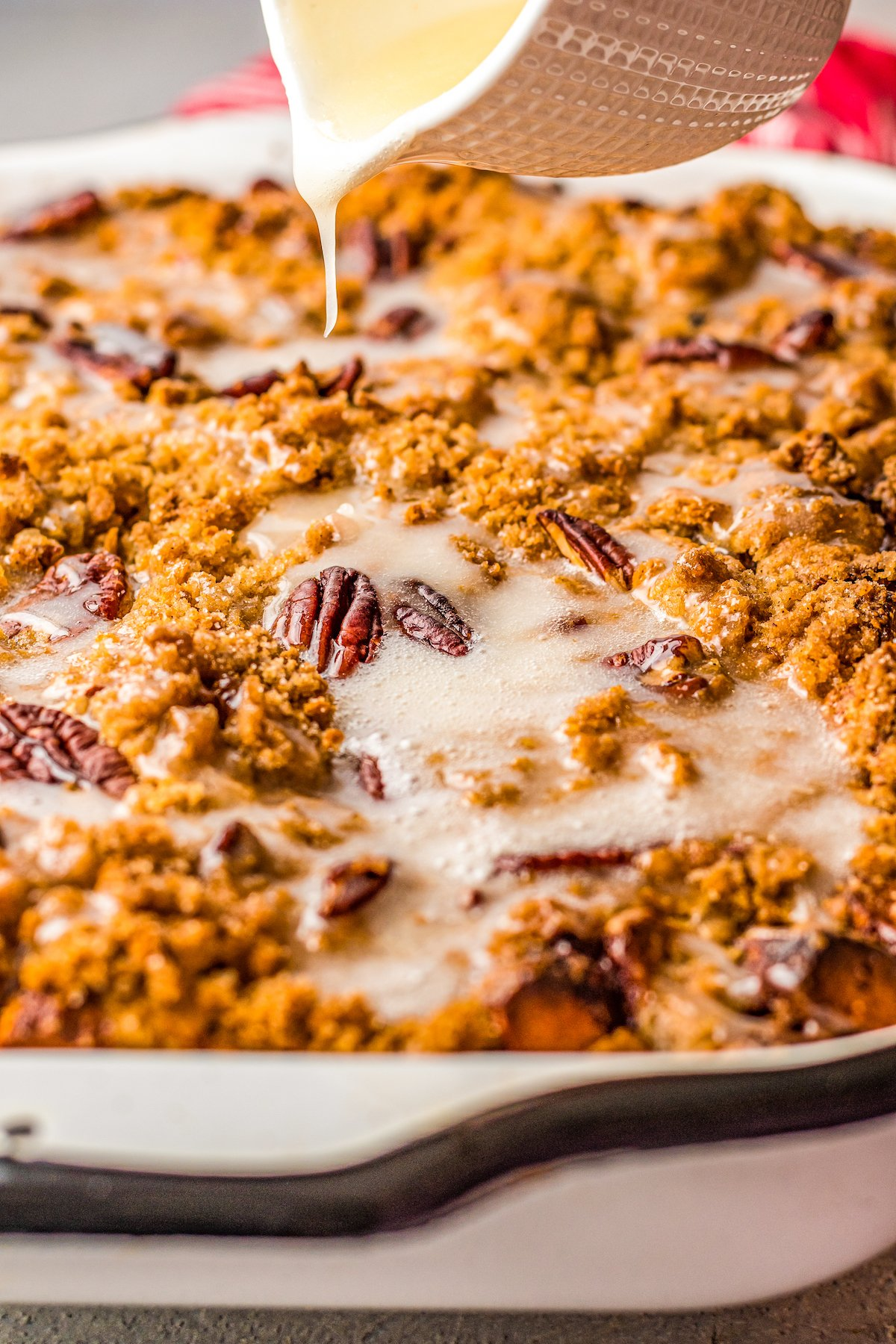 French toast casserole covered with cinnamon roll icing.