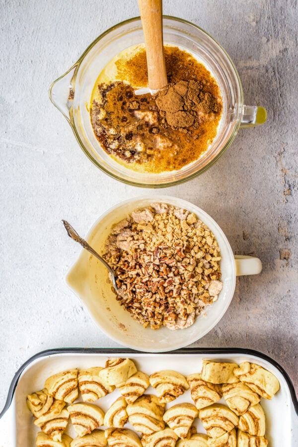 Custard, streusel, and cinnamon rolls, all in separate pans/bowls.