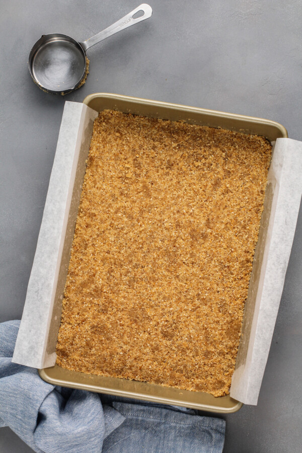 A prepared baking sheet is filled with crust.