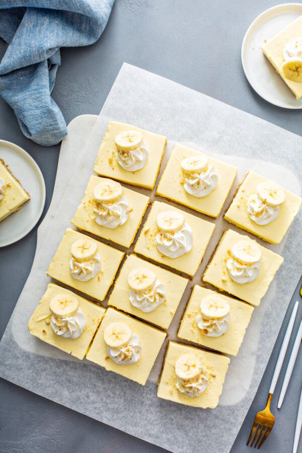 A block of banana pudding has been sliced into twelve even bars.