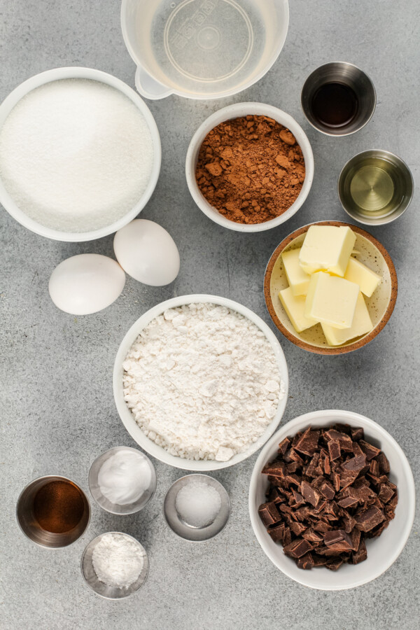 The ingredients for chocolate espresso cake are placed on a gray surface.