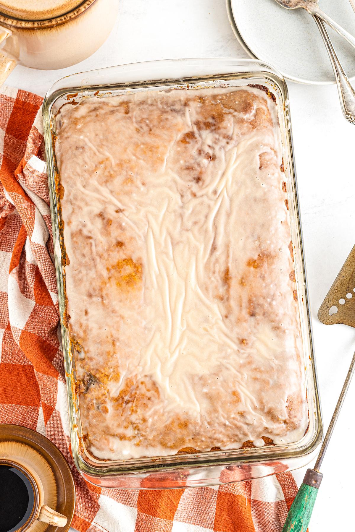 Glazed honeybun cake in a pan.