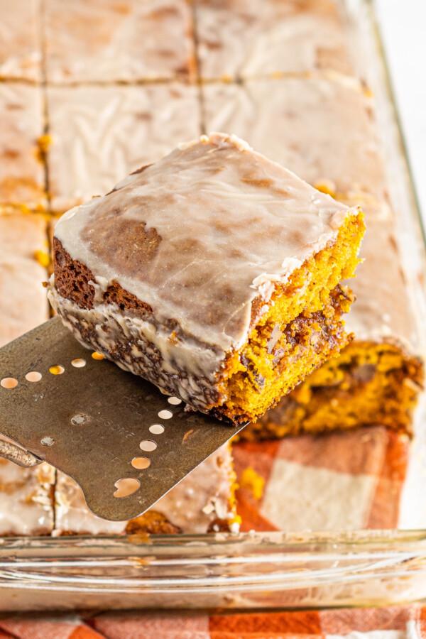 Slice of cake with cinnamon vanilla glaze.