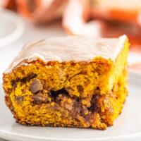 Slice of pumpkin honeybun cake with glaze and pecan filling.