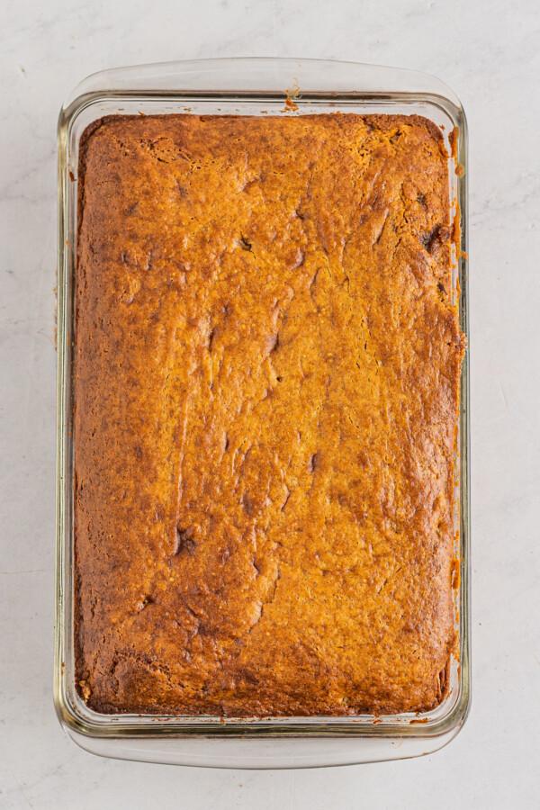 Baked honeybun cake in a pan.
