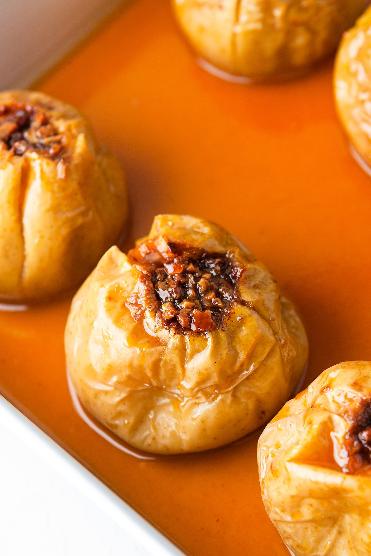 Golden apples stuffed with chopped nuts, brown sugar, and cinnamon.