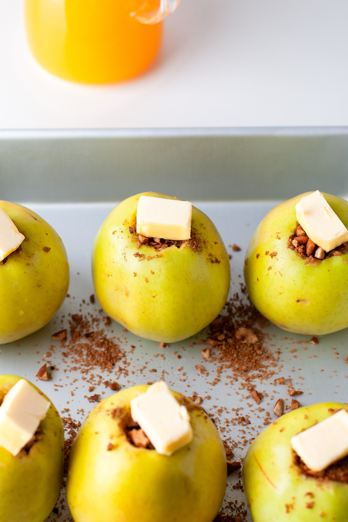 Stuffed apples with a pad of butter on top.