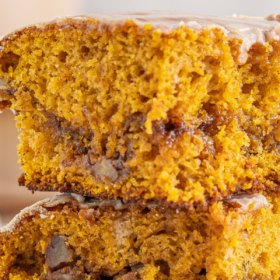 Two pieces of pumpkin honey bun cake stacked on top of each other.