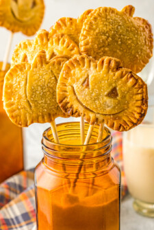 Pumpkin pie pops in a jar of sugar.