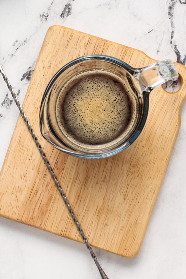 fresh brewed espresso in a measuring cup