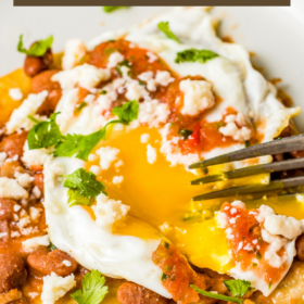 Up close image of Huevos Rancheros with the yolk broken with a fork.
