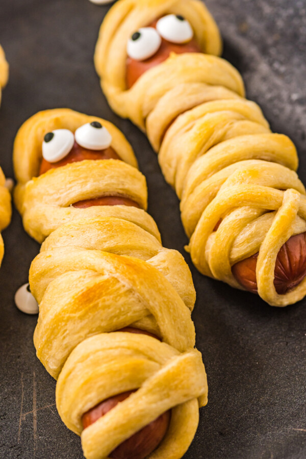 Mummy hot dogs with candy eyes.