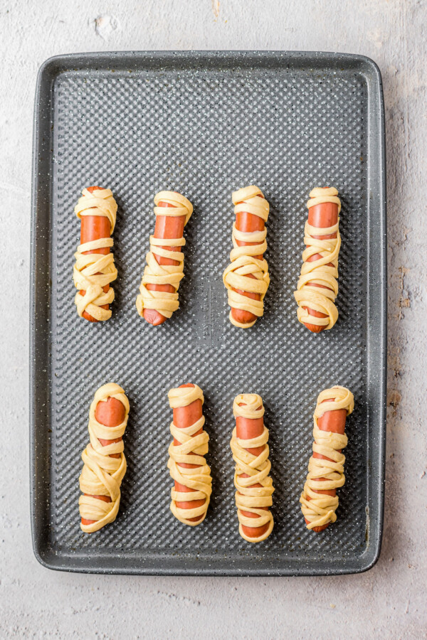 Hot dogs wrapped in crescent dough strips.